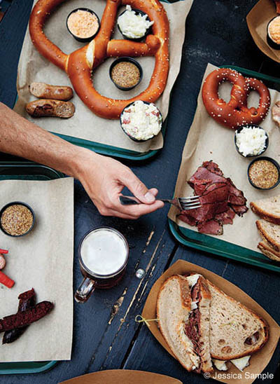 Spread of food and homemade pretzels at Easy Tiger in Austin, Texas
